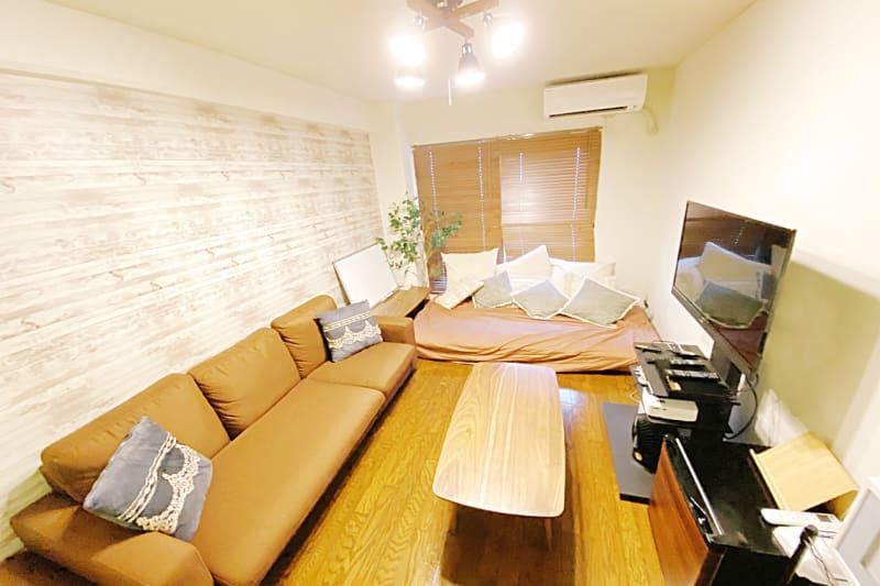 Wifi付きフルスペックRoom🎉クッション椅子4つ完備✨ - 🌸祝移転︰アイル心斎橋 高速Wifi+料理+ゲーム🎉の室内の写真