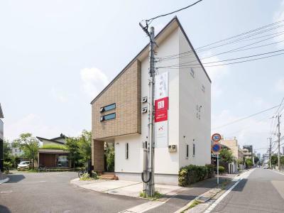 小倉町家 吹抜大空間のキッチン付スペースの入口の写真