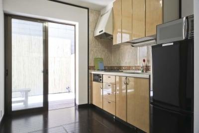 1Fのキッチン - pink building レンタルスペースの室内の写真
