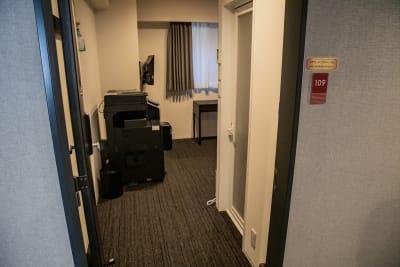 コピー機設置室入口 - メルディアステイIWAGAMI 会議室、レンタルスペースの設備の写真