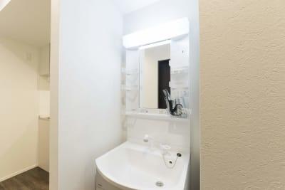 洗面台 - 尾久Ⅳ 102号室の設備の写真