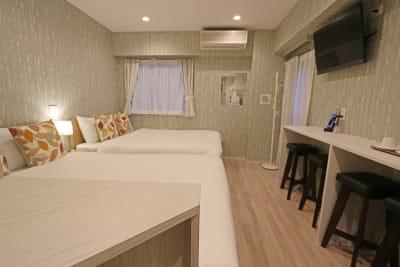 雅スタジオ ツインルームの室内の写真