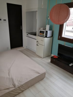 壁の緑色がさわやかです。 - Hikario新宿 ワークスペース 302の室内の写真