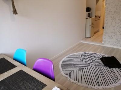 壁にかわいいインテリアがあります。 - Hikario新宿 ワークスペース201の室内の写真