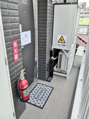 ゲストハウスqiao(チャオ) 多目的スペース302の入口の写真