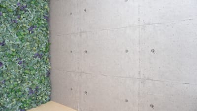 スライド壁で背景を変えることができます。 現在は2種類、写真はコンクリートの壁紙です。 - プレオープンPolano渋谷神泉 撮影配信パーティースペースの室内の写真